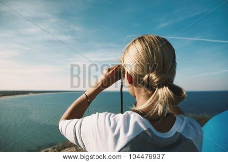 Young Woman Looking Through Binoculars On A Summer Nature