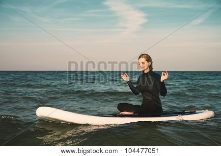 Stand Up Paddle Board Yoga Performed By Beautiful Girl On The Bright Sunset Background, Yoga Trainin