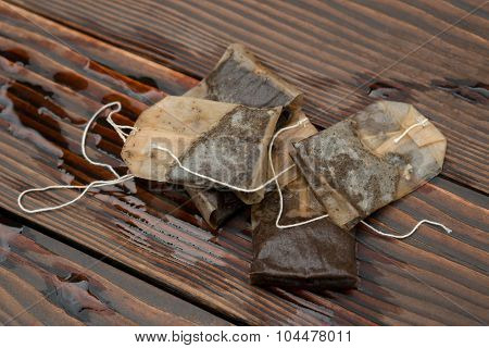 Used Teabags On A Wooden Background