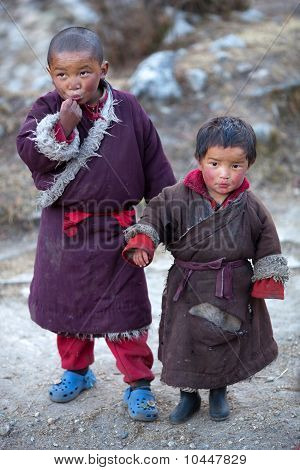 two young tibetan boys in national clothes