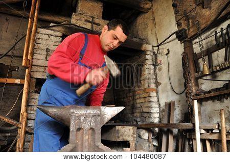 Hands Of Blacksmith Working Iron