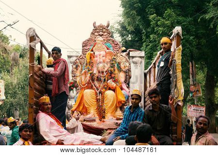 People carrying God Idol Ganesh for Immersion.