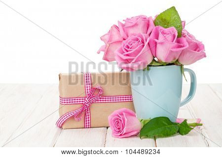 Valentines day pink roses bouquet and gift box on white wooden table