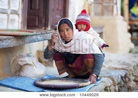Peasant Woman With Baby