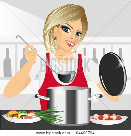 smiling young woman cooking in kitchen