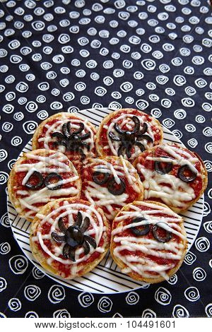 Mini pizzas decorated for a Halloween
