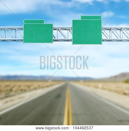 Pointer tracks, green road signs on the background of the road