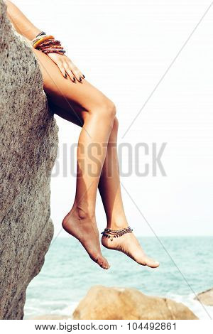 Girl Posing On Rocks Alone On Ocean Seashore