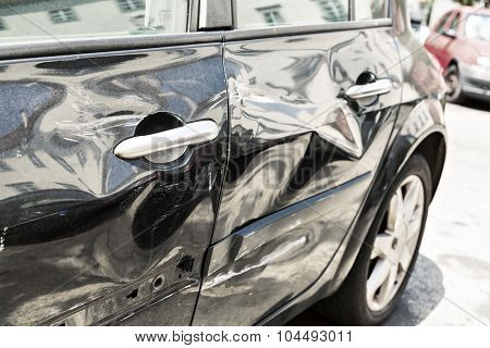 Black car with dent