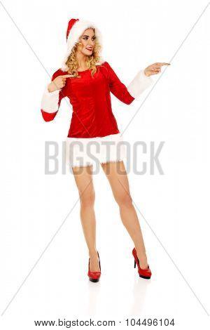 Beautiful santa woman pointing something.