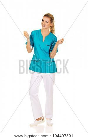 Smiling nurse or doctor holding a drip.