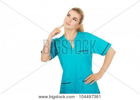 Smiling female nurse thinking about some idea.