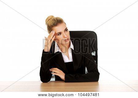 Beautiful businesswoman having huge headache.