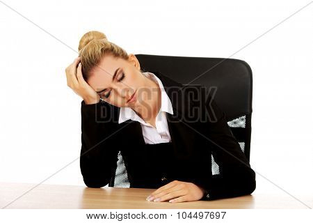 Tired young beautiful blonde businesswoman.