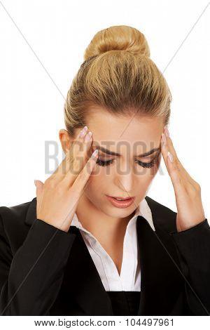 Young businesswoman having huge headache.