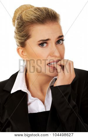 Stressed businesswoman biting her nails