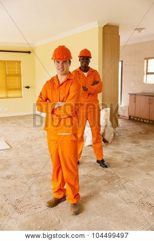 professional construction workers renovating a house