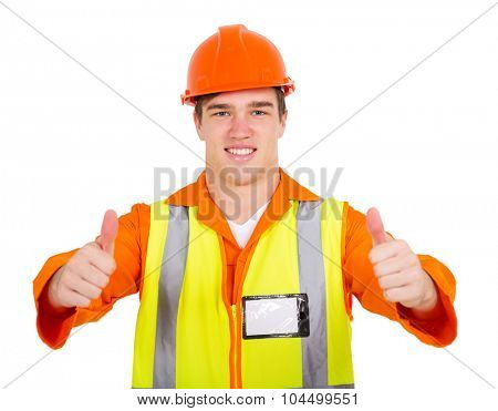 cheerful young contractor giving thumbs up