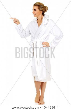 Young beautiful woman after bath shows somenthing, isolated on white.