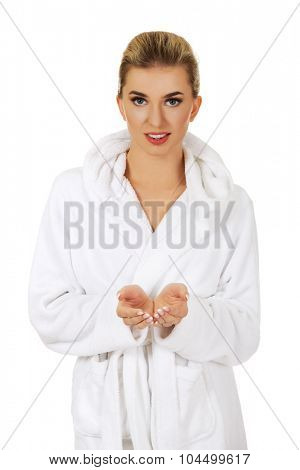 Smile woman holding something in her hands, isolated on white.