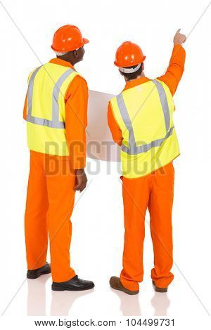 rear view of construction co-worker pointing on white background