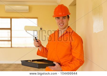 young contractor painting inside the house