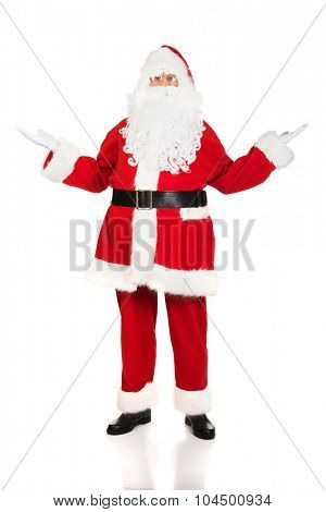 Full length traditional Santa Claus showing a copyspace.