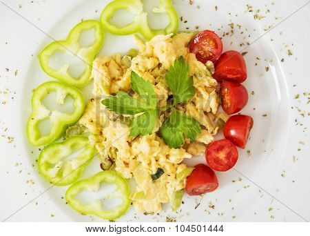 Scrambled Eggs With Paprika, Cherry Tomatoes And Celery Leaves