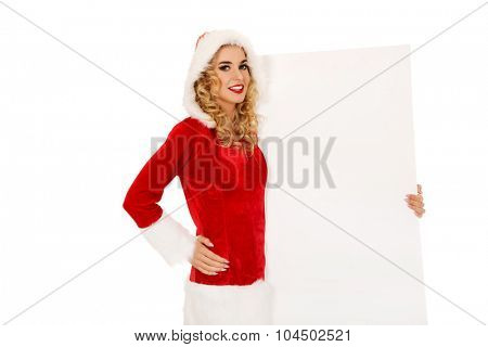 Santa woman holding white empty banner.