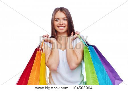 Young smiling consumer carrying paperbags