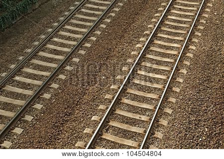 A pair of railway tracks viewed from above
