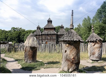 Ancient Beehives Nearby Wooden Church