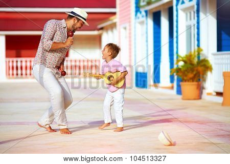 Happy Family Playing Music And Dancing On Caribbean Street