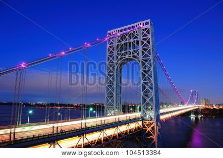 George Washington Bridge at dusk over Hudson River.