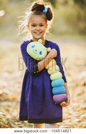 cheerful little girl with soft toy