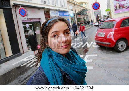 Close-up Portrait Of Beautiful Girl In Paris City