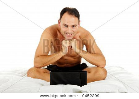 Caucasian Middle Aged Man In Bed, Laptop