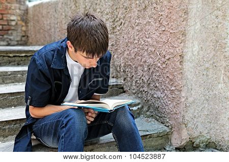 Teenager With The Book Outdoor