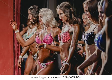 girls fitness bikini stand in the front position
