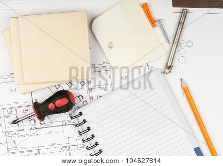 Copy book with tiles and screwdriver