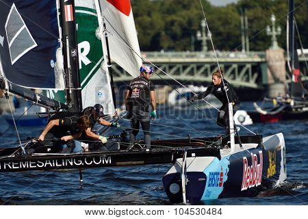 ST. PETERSBURG, RUSSIA - AUGUST 22, 2015: Catamaran of Red Bull Sailing Team of Austria during 3rd day of St. Petersburg stage of Extreme Sailing Series. The Wave, Muscat team leading after 2 days