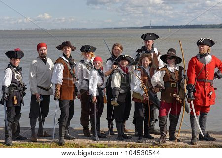 LOMONOSOV, ST. PETERSBURG, RUSSIA - AUGUST 29, 2015: Participants of the Oranienbaum maritime festival with swords and bows. This annual festival is held since 2011