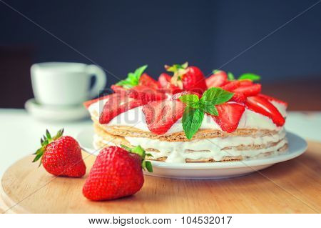 strawberry cake with mint twig