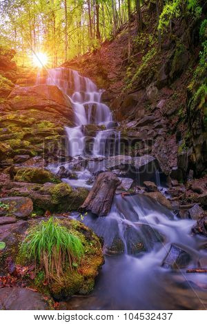 waterfall on mountain in summer time