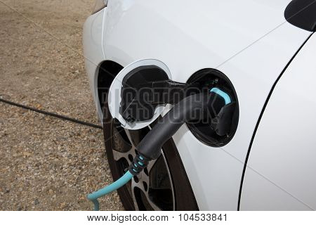 An Electric Car Refuel With A Power