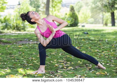 Young yoga teacher practicing outdoors in a park in Barcelona