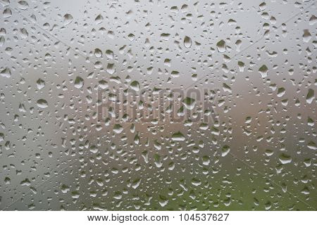 Glass surface with water drops in a rainy day
