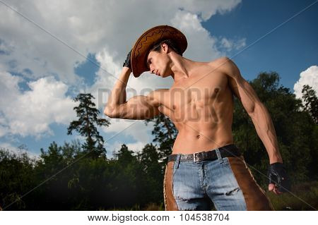 Sporty, Athletic, Muscular Sexy Man In A Cowboy Outfit