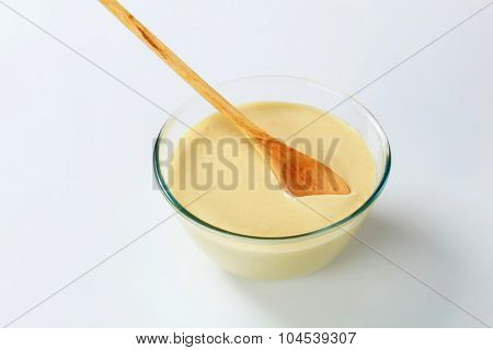 bowl of raw batter and wooden spoon