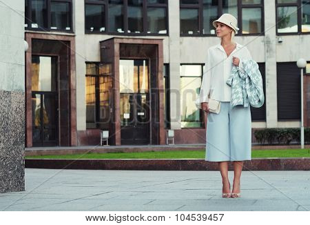 young fashion  blond woman walking on the street